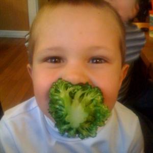 The boy likes broccoli...